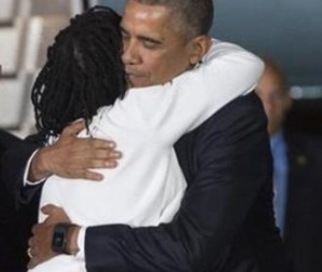 Obama Hugging his sister Auma Obama shortly after landing at JKIA, Kenya