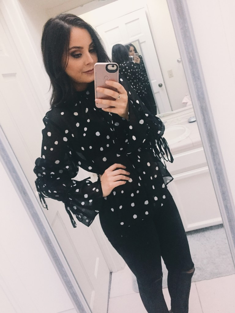 Nordstrom Anniversary Sale. Black ripped jeans with black and white polka dot blouse.