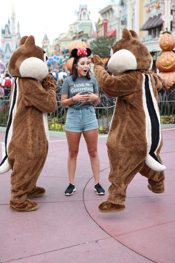 Chip and Dale surprising a guest at Disney World