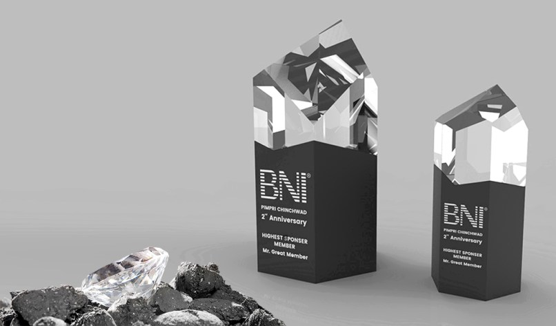 A trophy set designed for a corporate event inspired from glowing diamond in a coal mine.