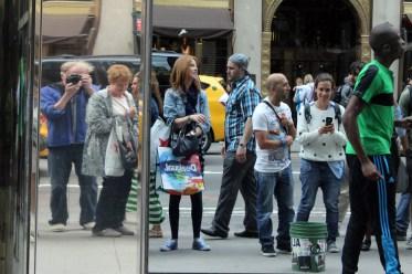 Reflection of me as I make a take a photo of crowd