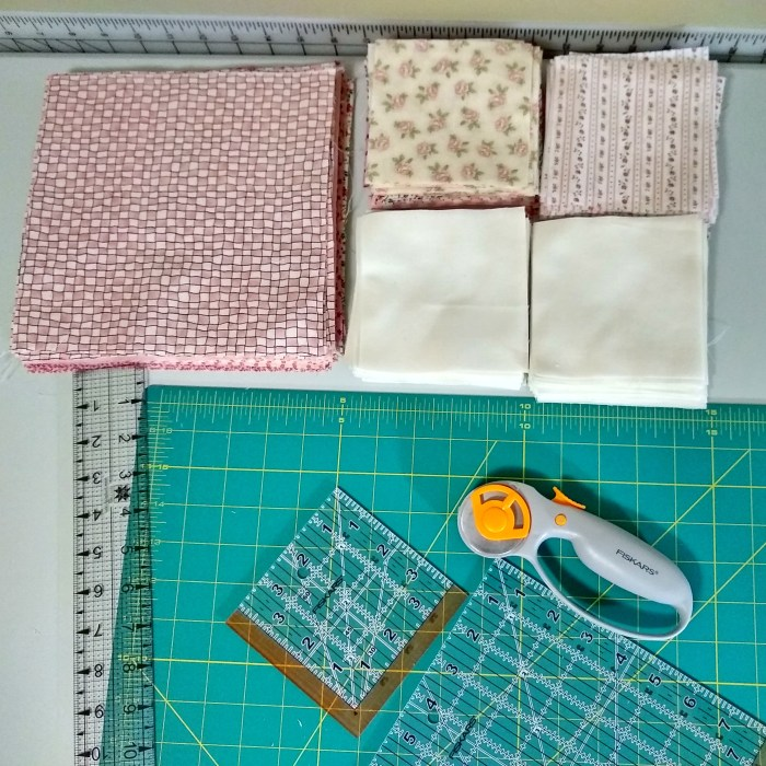 Sewing machine and squares of fabric