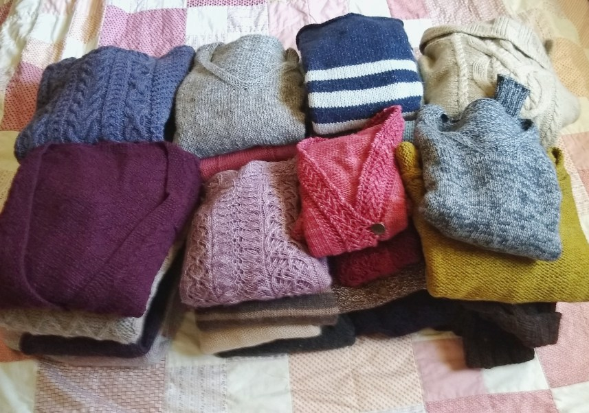 A pile of handmade sweaters
