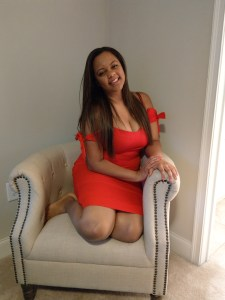 Red Abercrombie and Fitch dress and off white tufted studded chair