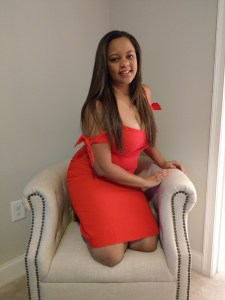 Red Abercrombie and Fitch dress, long brown hair and off white tufted studded chair