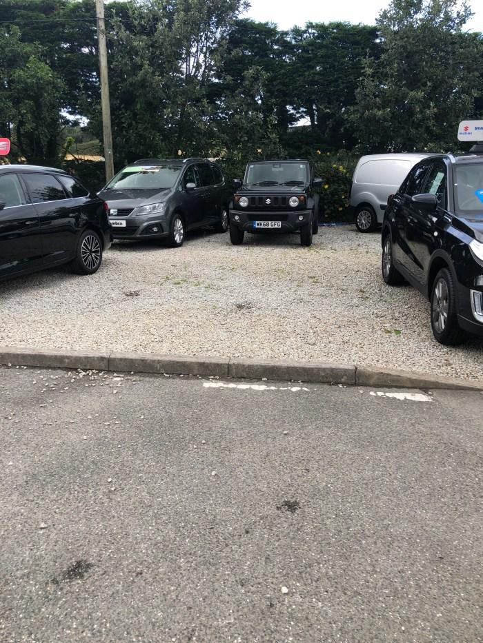 Suzuki Jimmy 2019 next to normal cars