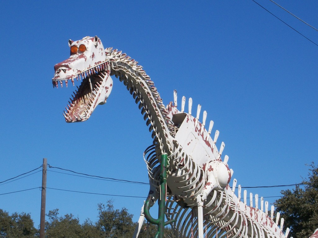 Car parts dinosaur in Bertram, Texas.