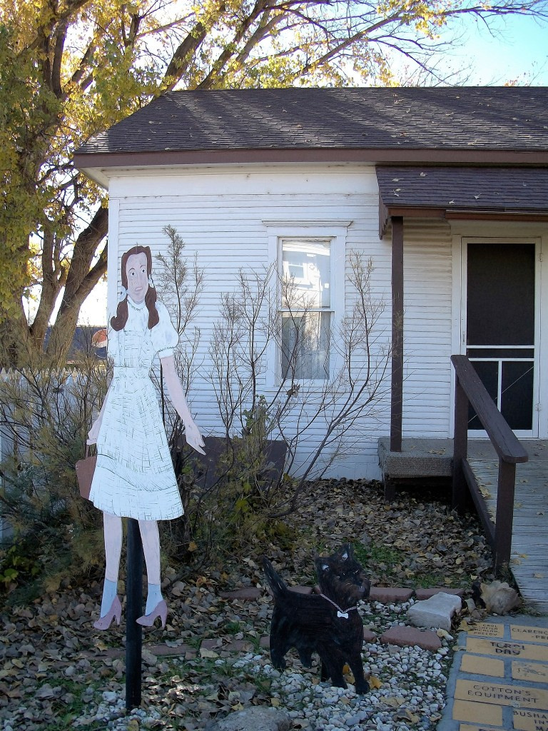 Dorothy and Toto in front of her house.