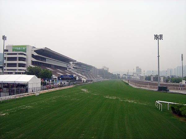 famous Hong Kong Jockey Club racetrack......riders are permitted to gallop on the track. Now that must be fun!