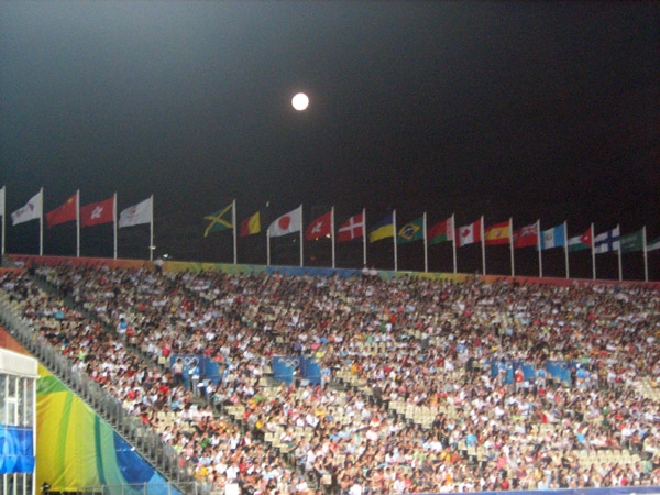 a full moon rising over the international flags