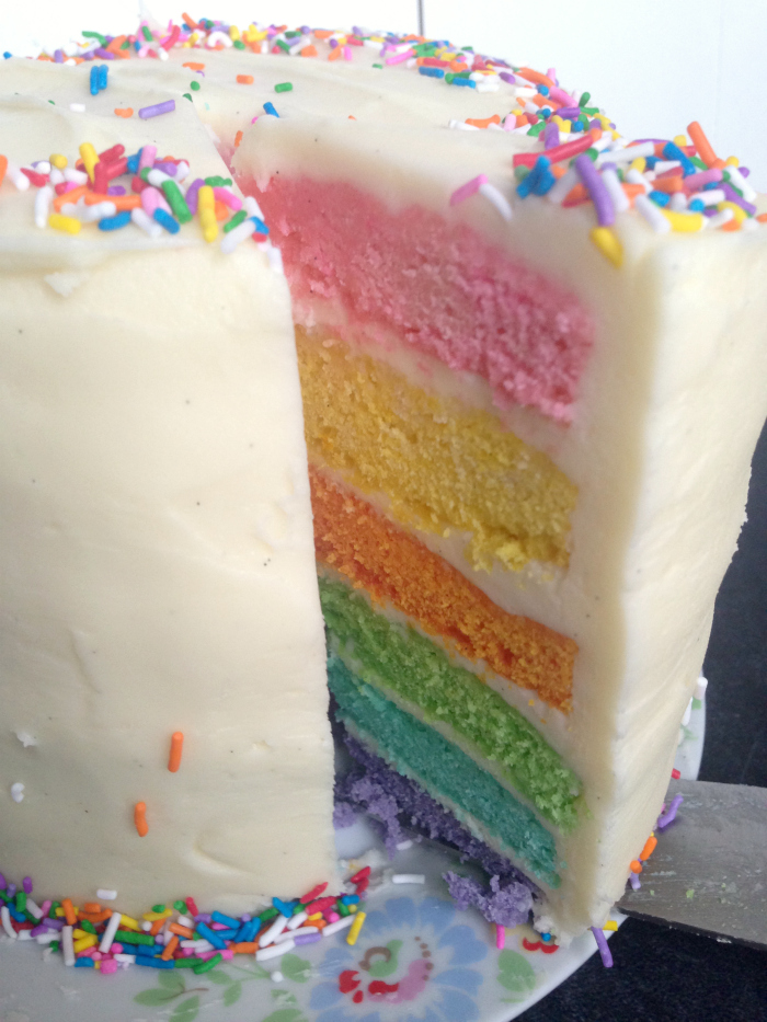 Pastel Rainbow Cake - so pretty and perfect for ladies lunches or Easter dinners! Plus, it's topped with the most delicious thick cream cheese frosting!