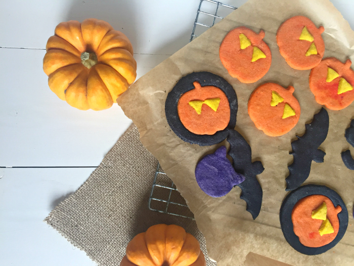 So colourful - these yummy easy Halloween cookies start with a simple sugar cookie dough, which is coloured and cut out into spooky shapes! Kids will love them!
