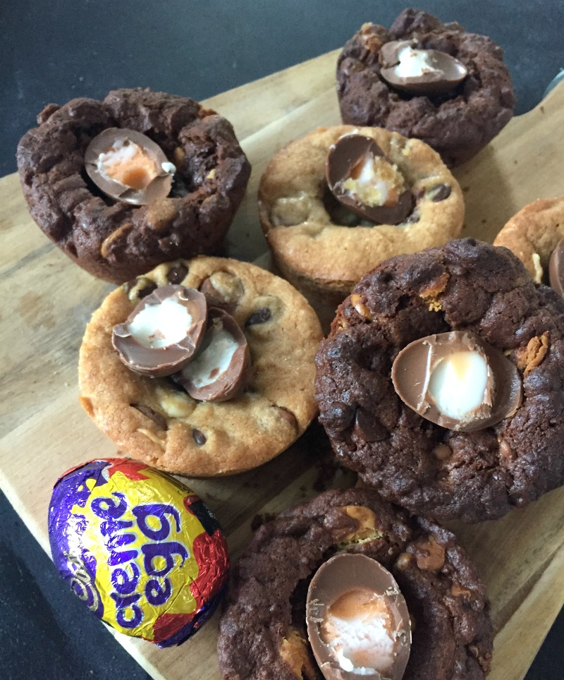 Thick, chewy and chocolate chunk packed cookie cups topped with a Cadbury Creme Egg..... do Easter treats get any better than this?! Cadbury Creme Egg Cookie Cups