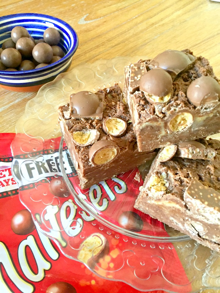 Love Maltesers? You'll LOVE this Easy No Bake Malteser Chocolate Slice recipe - it's a TRIPLE Malteser hit with Malteser chocolate, malt powder and chopped Maltesers! No Bake and five minutes to make! Easy quick No Bake Malteser Recipe