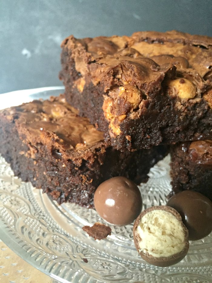 Chewy thick Malteser Chocolate Brownies! A super easy recipe for yummy dense chocolate fudge brownies with malty Horlicks powder and plenty of maltesers!