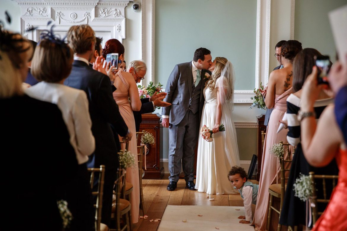 kiss at Botleys Mansion wedding