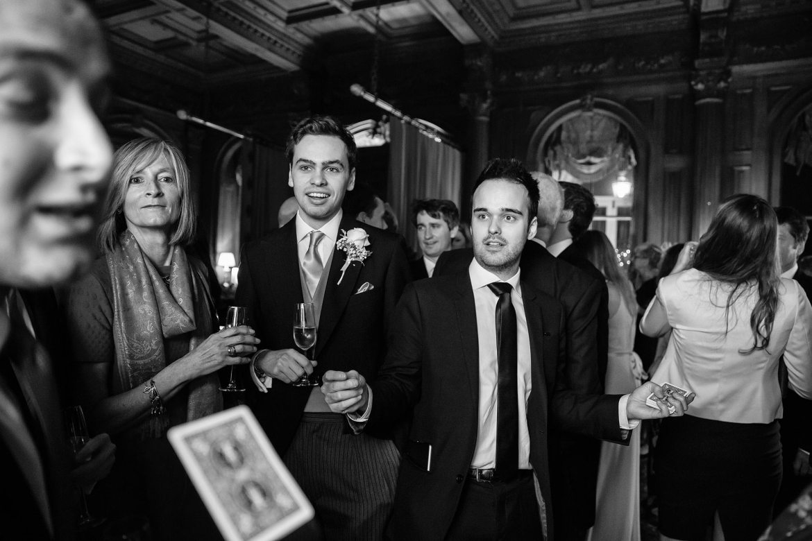 cards flying at winter wedding Cliveden House