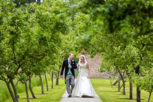 Walking through the orchard at Fulham Palace Wedding