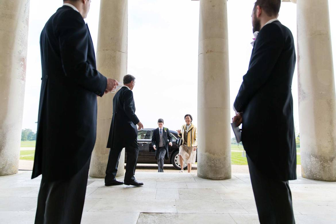 Guests continue to arrive for Rachel and Kieran's Goodwood House wedding