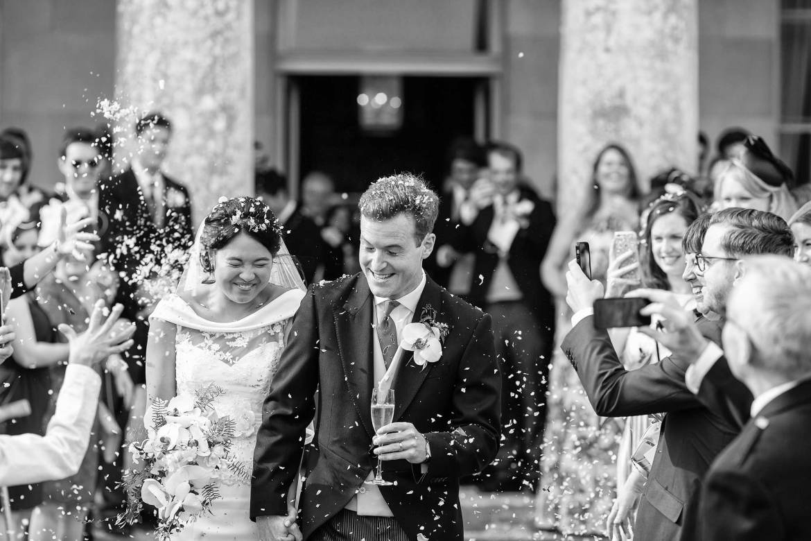 The couple wince as the confetti hits them