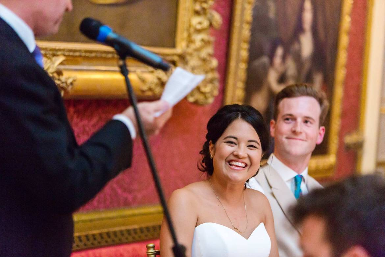 Rachel laughs at her father's speech