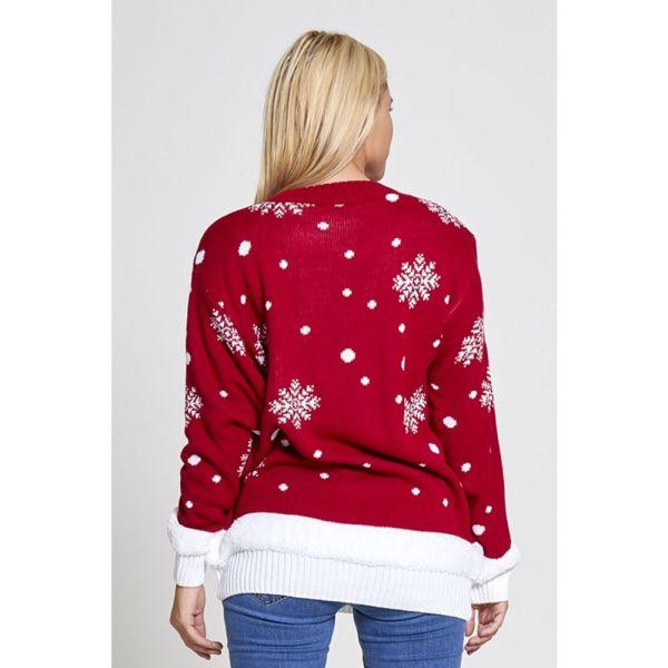 Rode dames kersttrui met tricot manchetten aan de hals, mouwen en taille. De kersttrui is op devachterzijde versierd met verschillende sneeuw patronen.