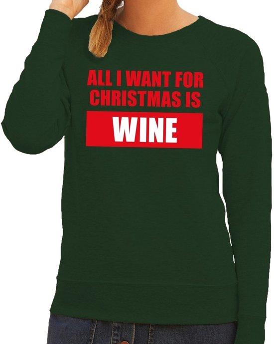 """Groen dames kersttrui met aan de voorzijde de tekst """"all I want for christmas is wine""""."""