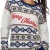 """Witte dames kersttrui met blauwe tricot manchetten aan de hals, mouwen en taille. De kersttrui is versierd met Noorse patronen en met op de borst de tekst """"merry christmas""""."""