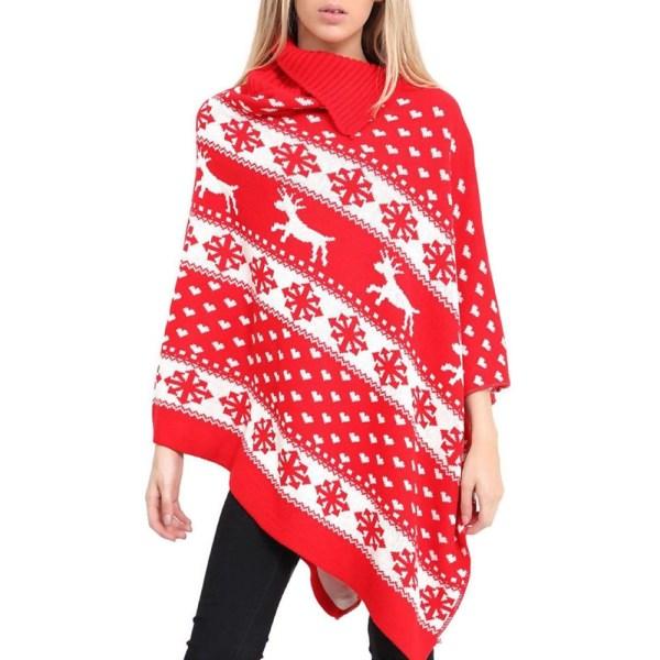 Op de foto is een blonde dame te zien die een rode kerst poncho draagt. Op de kerst poncho zijn sneeuwvlokken en gekleurde 3D pom poms te zien. Dit is de dames kleding trend voor kersttruien in 2019!