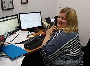 Kristin on the phone smaller