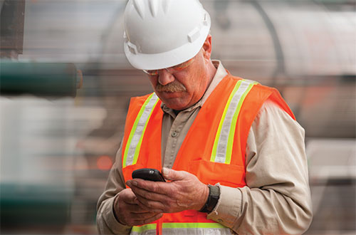 worker-on-cell-phone-distracted-may2013