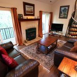 Living room has views of Baldy, gas fireplace, and deck