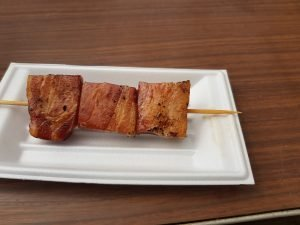 A skewer with large pieces of pork