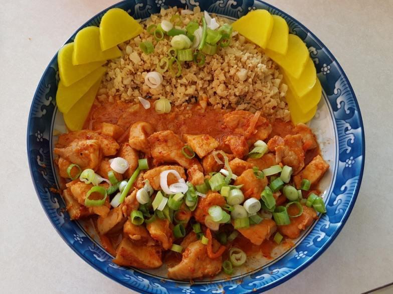 Korean spicy chicken stir fry (dakgalbi) with fried garlic cauliflower and danmuji