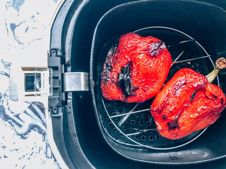 Roasted red bell peppers in an air fryer basket