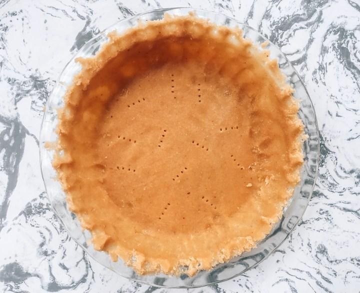 Raw pie crust in a glass pie dish