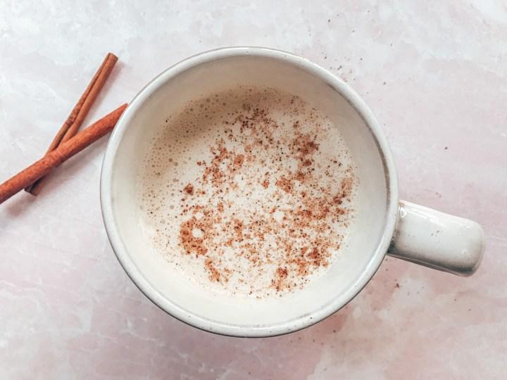 Eggnog in a mug with nutmeg and cinnamon