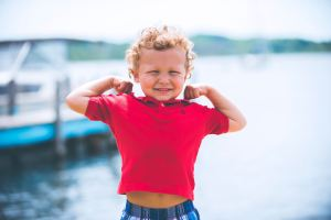 keto kid flexing muscles