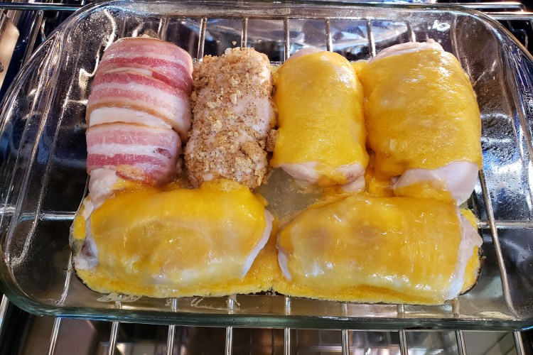 All six pieces of Cordon Bleu with cheese melted on top and in the hot baking dish.