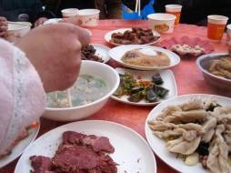"""Sichuan wedding food, including pídàn, or """"thousand year eggs,"""" which are preserved in a strange mixture of ash, salt, and more. I think they're yummy, but lots of people don't."""
