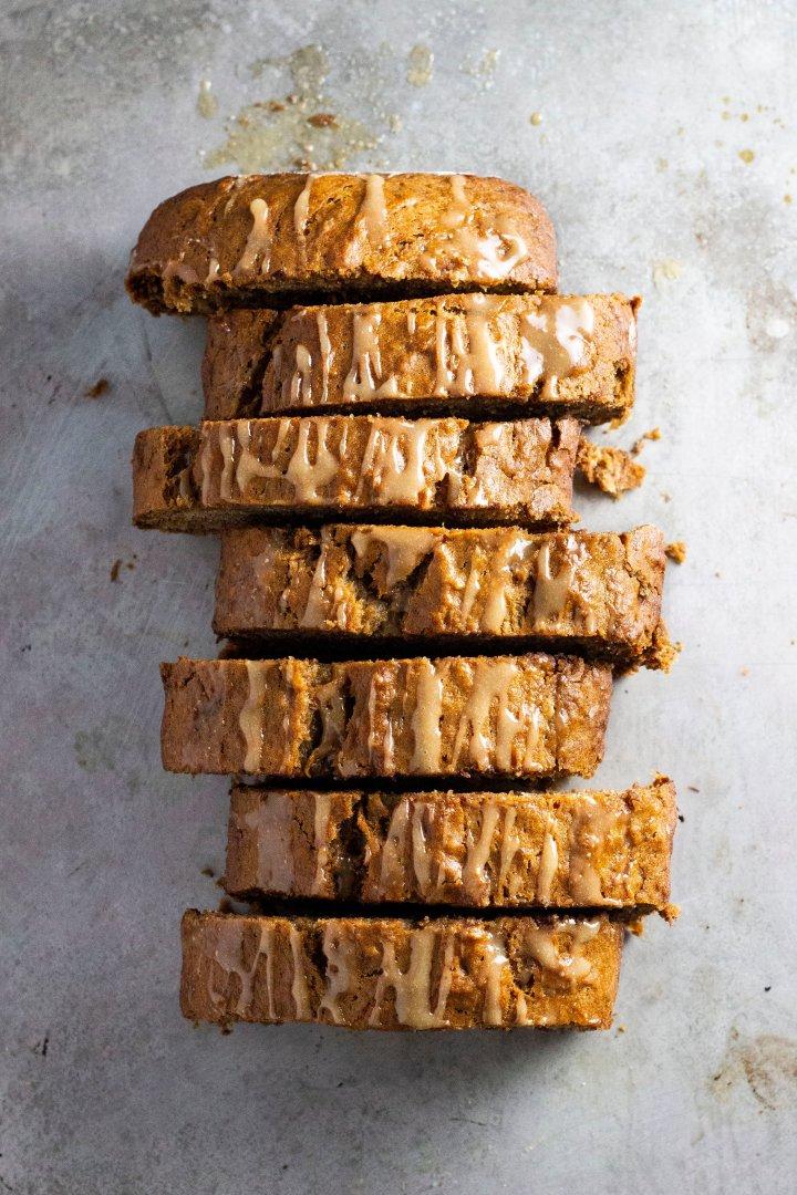 An overhead shot of peanut butter banana bread on a silver, baking pan.