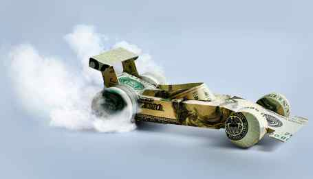 picture of a money shaped car doing a burn out