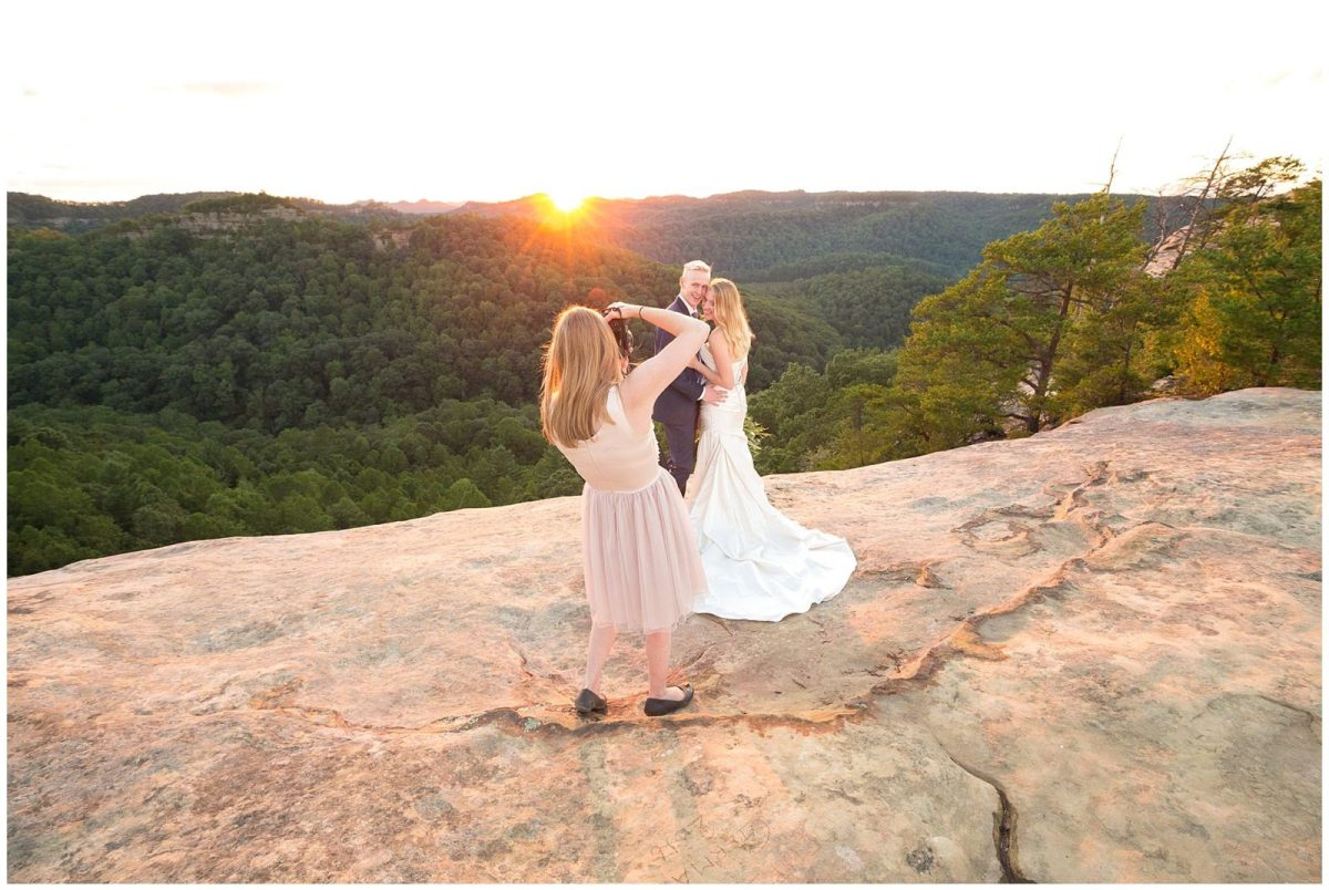 Wedding photographer photographing a bride and groom in the Red River Gorge in Kentucky