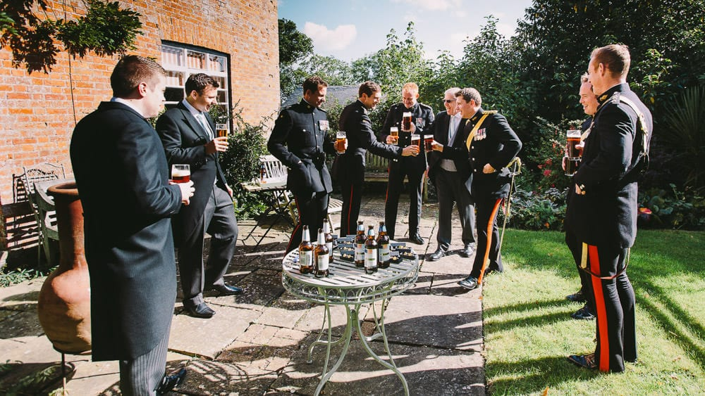 Military Groom has a pint with his honour guard before the wedding