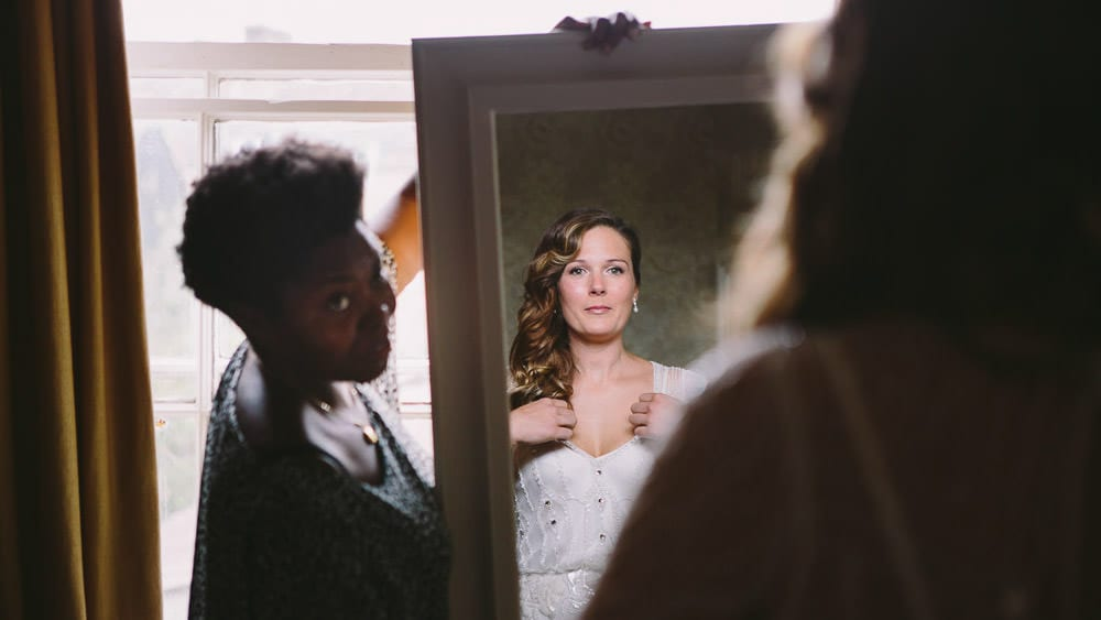 Bride in the mirror looking at her dress