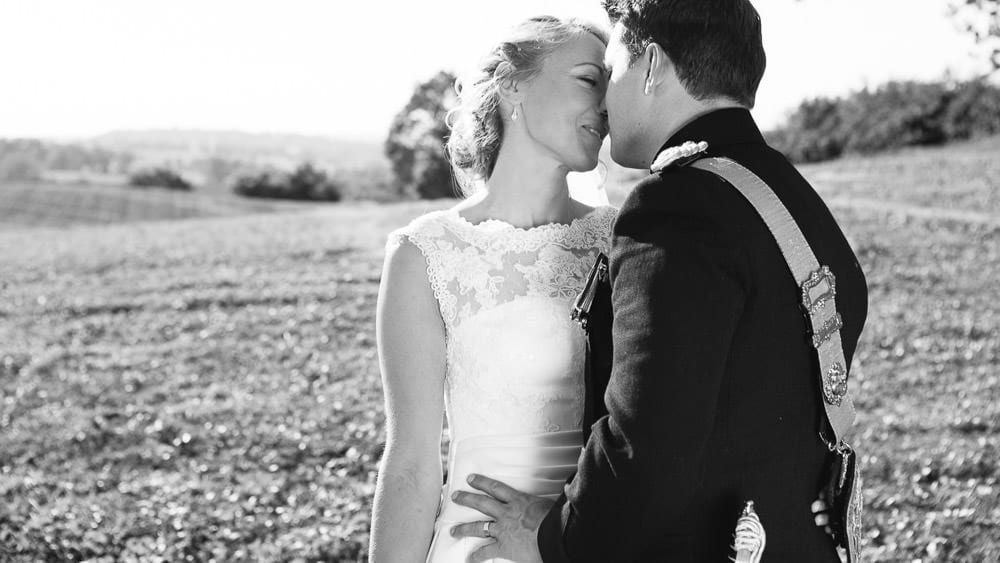 A military groom and his new wife take a moment