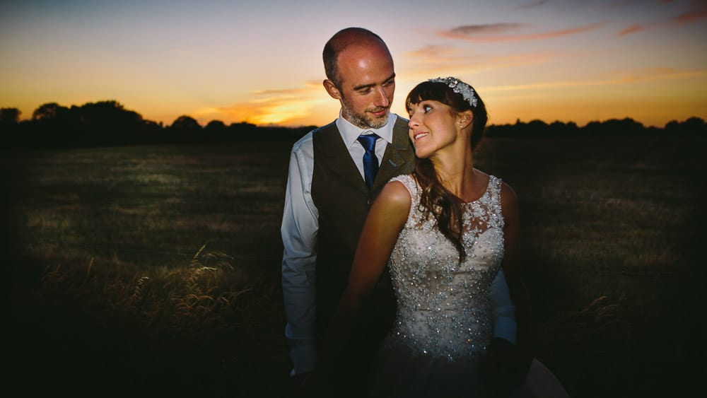 Sunset portrait of bride and groom at Great Tythe Barn