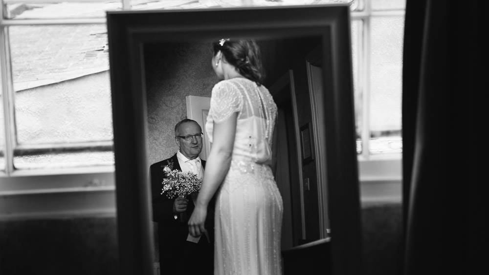 Black and white image of bride and her father before Grittleton ceremony