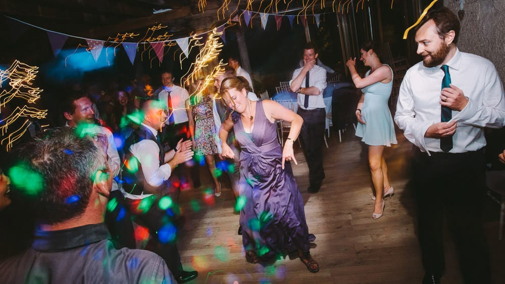 Bridesmaid dancing at Abbey House Gardens wedding