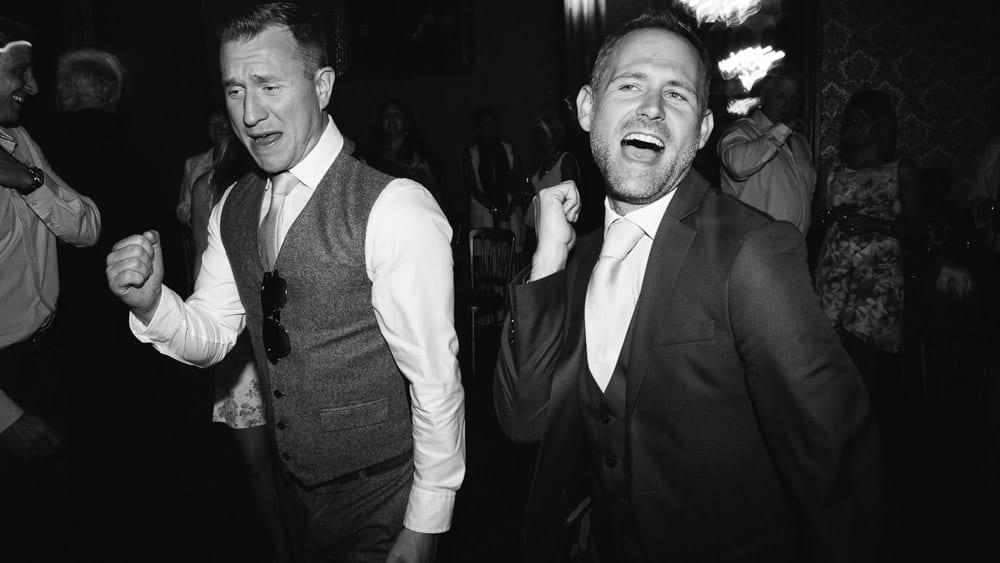 Groomsmen dancing at Grittleton